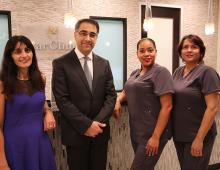 Dr. & Mrs. Azadi with staff at office reception desk