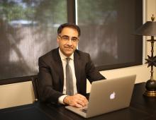 Dr. Azadi sitting at desk